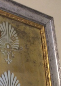 Distressed shell mirror close up